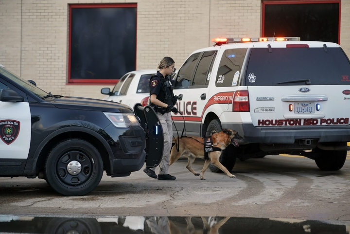 A Houston Independent School District Police K-9 unit responds to a shooting, Tuesday, Jan. 14, 2020, at Bellaire High School in Bellaire, Texas. (Mark Mulligan/Houston Chronicle via AP)