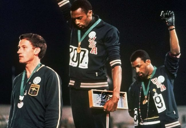 John Legend, Jesse Williams to Exec Produce WITH DRAWN ARMS Documentary on Tommie Smith's Salute at 1968 Olympics