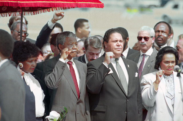 Maynard Documentary. Atlanta. Mayor Maynard Jackson (C) and Coretta Scott king, widow of slain civil rights leader Dr. Martin Luther King, Jr., join Nelson Mandela in holding up clenched fists during the playing of the Anthem of Mandela's African National Congress upon Mandela's arrival.