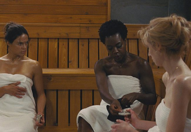 L-R: Michelle Rodriguez, Viola Davis, and Elizabeth Debicki star in Twentieth Century Fox's WIDOWS. Photo Credit: Courtesy Twentieth Century Fox.