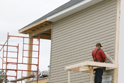 Washington home siding specialist on a scaffold