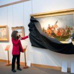 collector-mary-burrichter-with-mmam-curator-jon-swanson-unveiling-emanuel-leutze-masterpiece