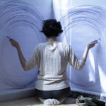 Choreographer Winona Minnesota Workshops Dance Lecture Photo of Woman drawing circles on two surfaces