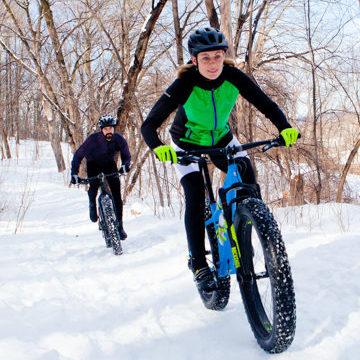 couple riding fat tire bikes in snow