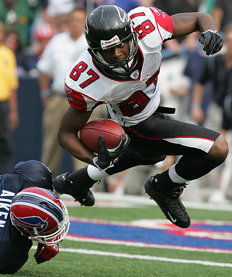 Atlanta Falcons kickoff return Romby Bryant (87) moves the ball upfield before being dumped by Sam Aiken (89) during the game against the Buffalo Bills at Ralph Wilson Stadium in Orchard Park, New York. on Sept. 25, 2005. The Falcons defeated the Bills 24-16.