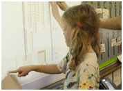 A student pointing on a smartboard
