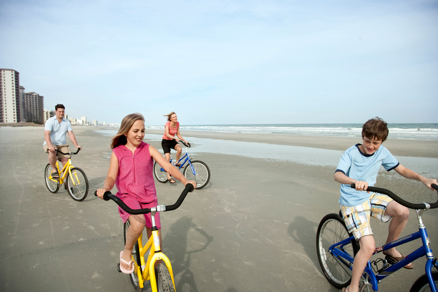 Family Bike Riding on the Beach in the city of Myrtle Beach