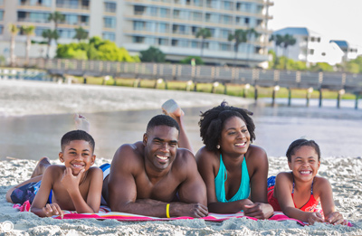 Family on the beach in front of Ocean Creek Resort near North Myrtle Beach