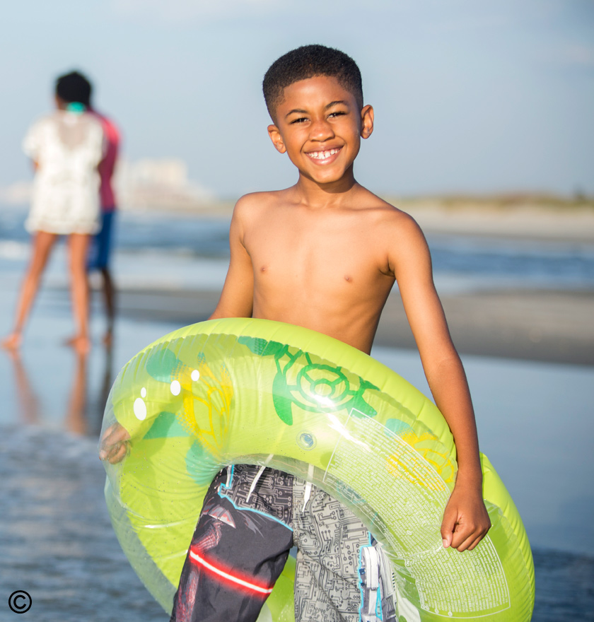 Child enjoying summer at Ocean Creek Resort
