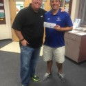 Athletic Director Jared Fribush of Blake High School and VNN's Brian Shuster with payback check