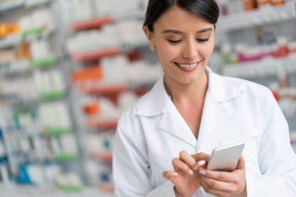 Pharmacist using app at a drugstore