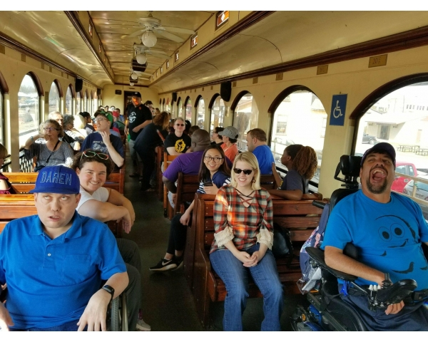 Caregiver during Train Ride for Individuals with Disabilities