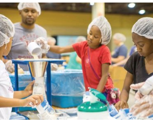 Serving Locally, Impacting Globally: Pack Life-Saving Meals for Hungry Children
