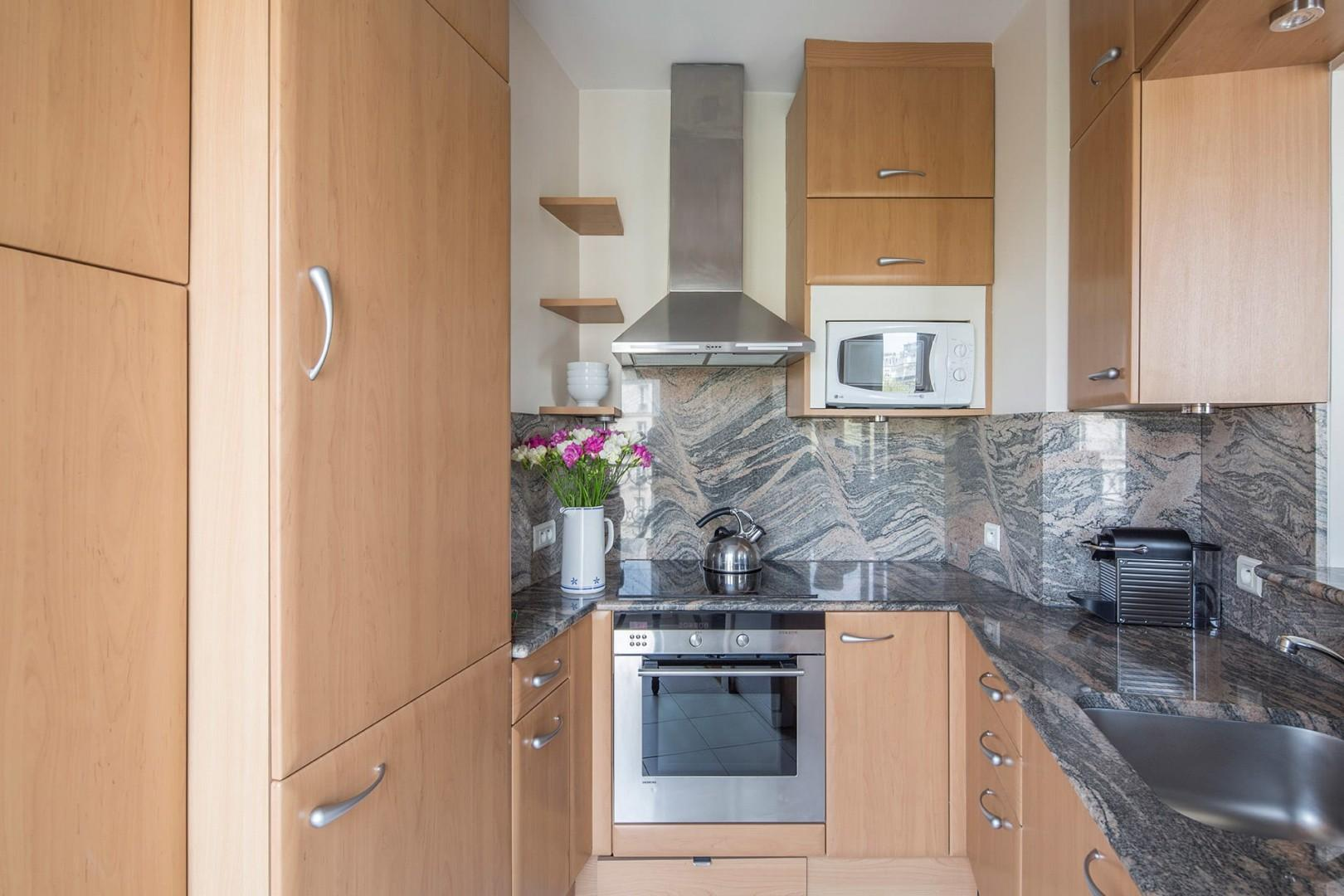 The modern, fully equipped kitchen comes with a dishwasher and Nespresso maker.
