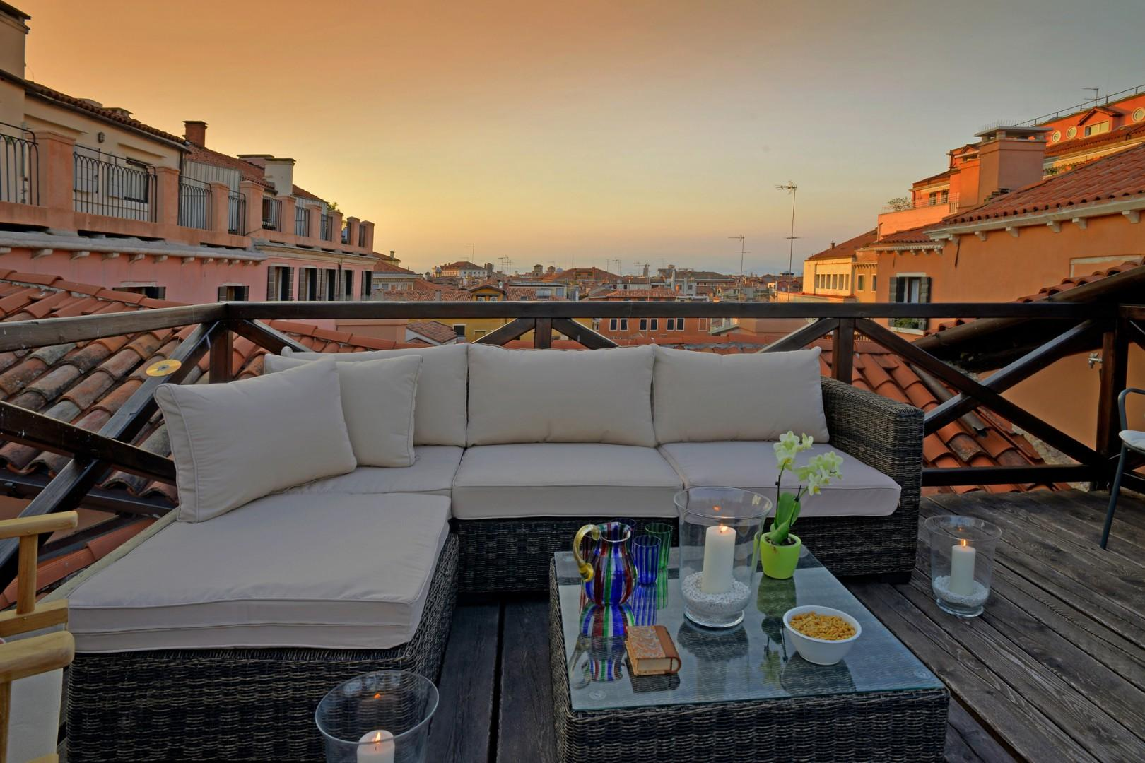 Toast the sunset from your private terrace that overlooks Venetian rooftops and cupolas.