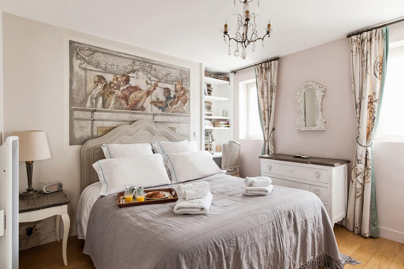 The sophisticated bedroom 1 features a large and comfortable bed.