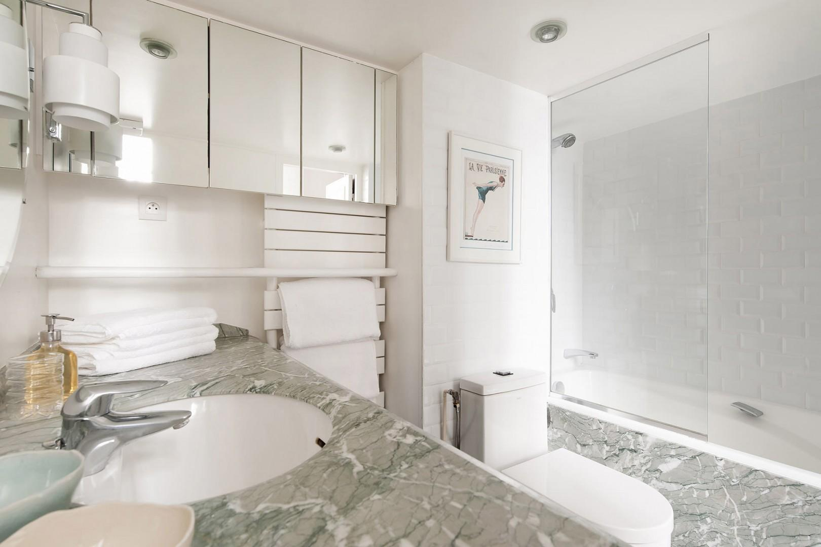 Pamper yourself in the sleek and functional bathroom.