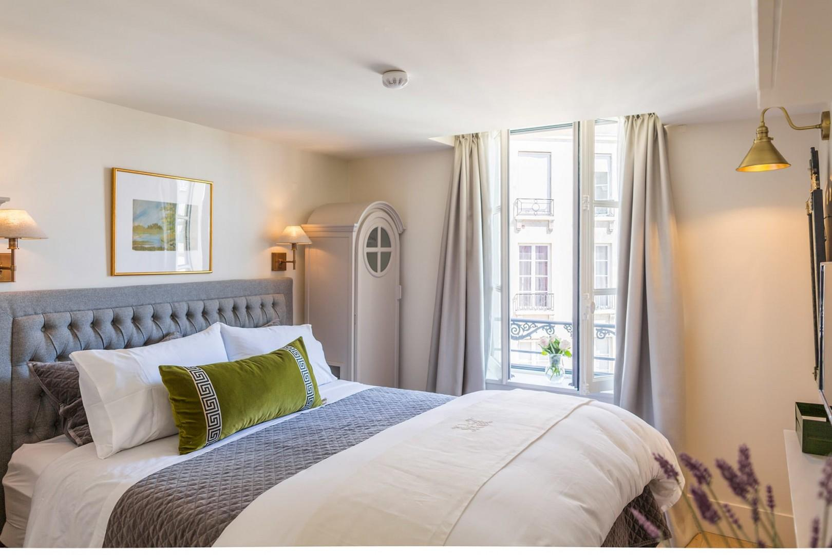 The bedroom comes with a comfortable bed and en suite bathroom.