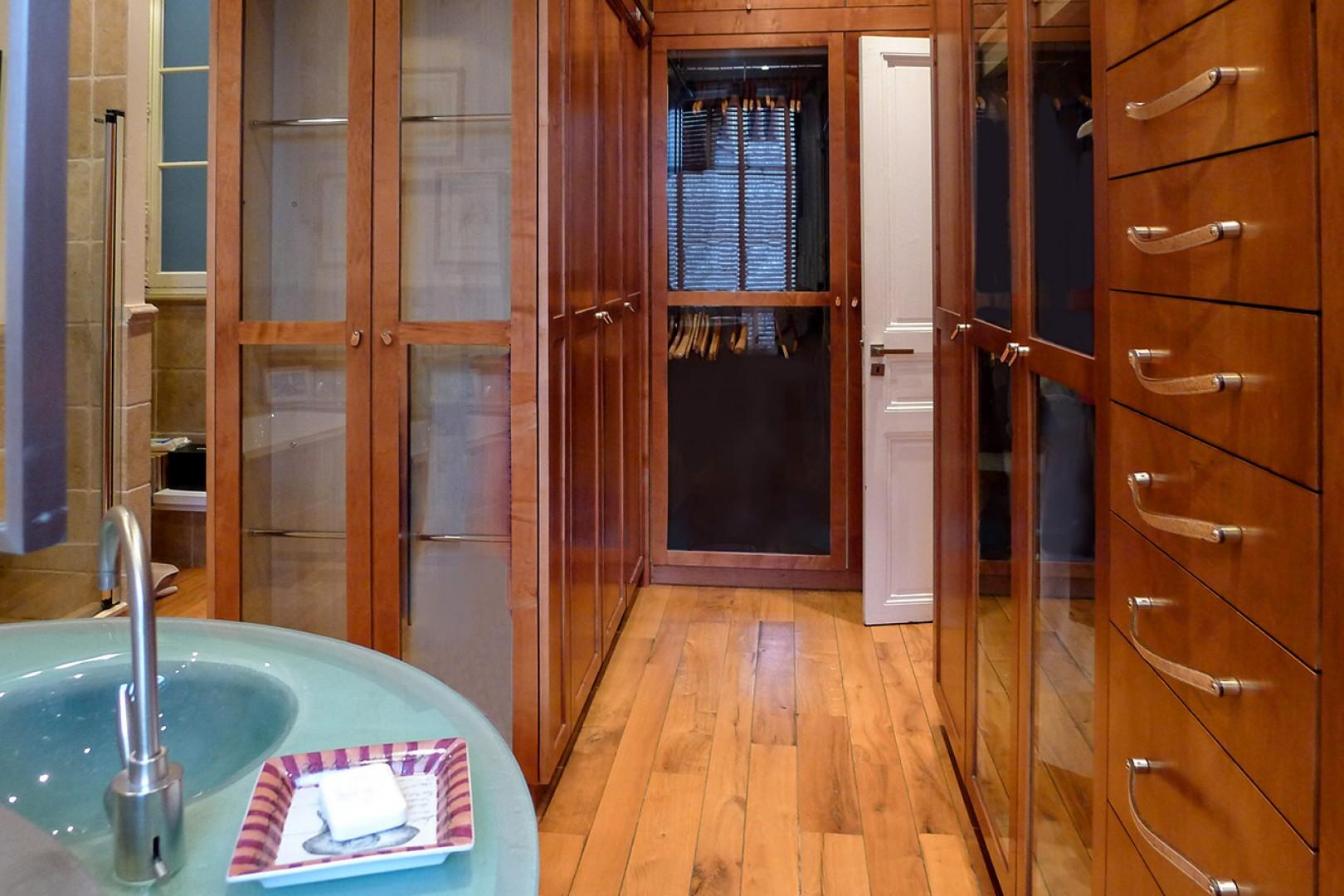 There are also handcrafted teak closets with glass doors.