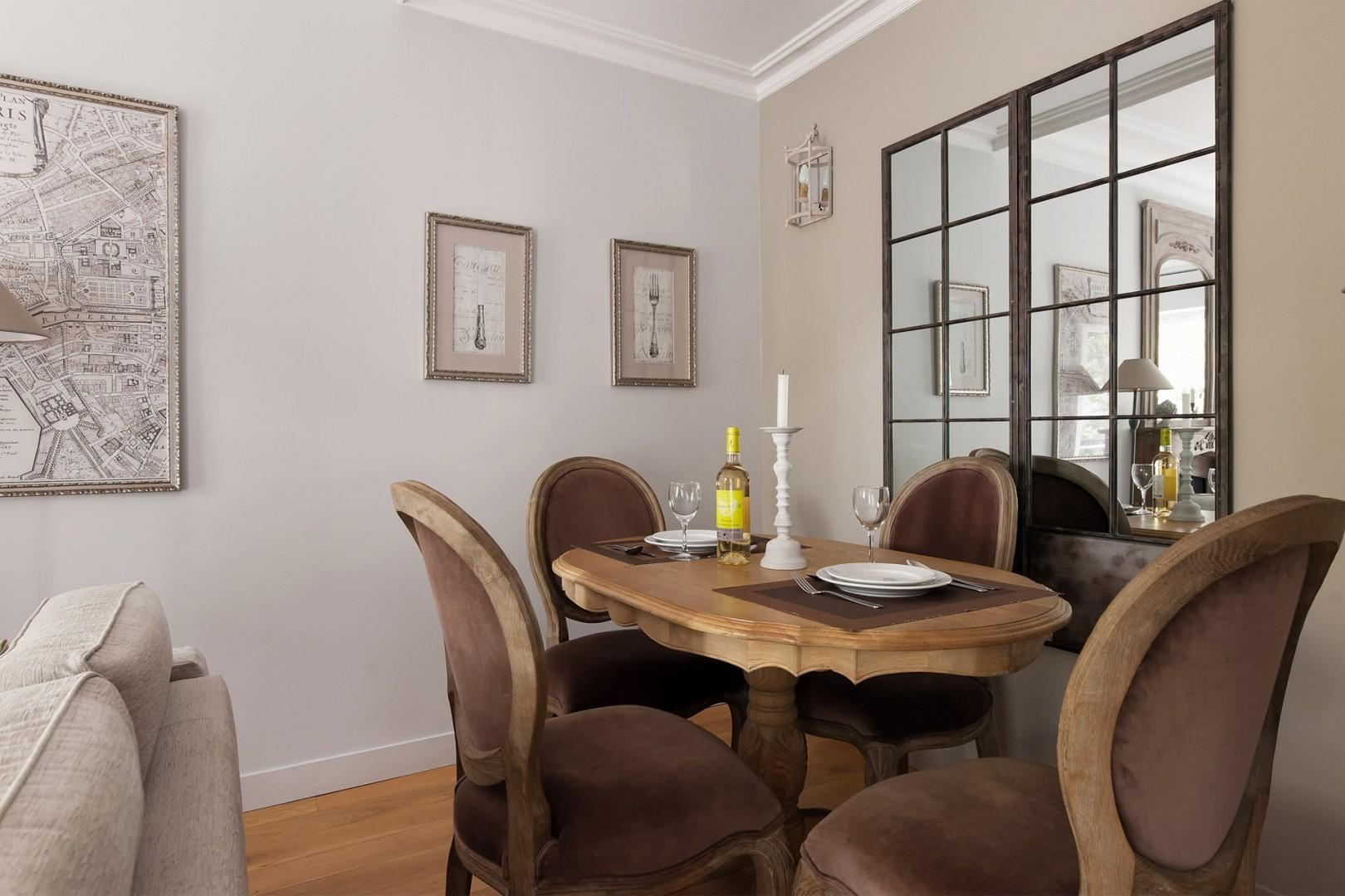 Enjoy French-style dinner parties at this elegant dining table for four.