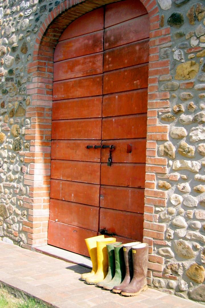 The doors below the house open to the cantina where the Chianti wine is made.