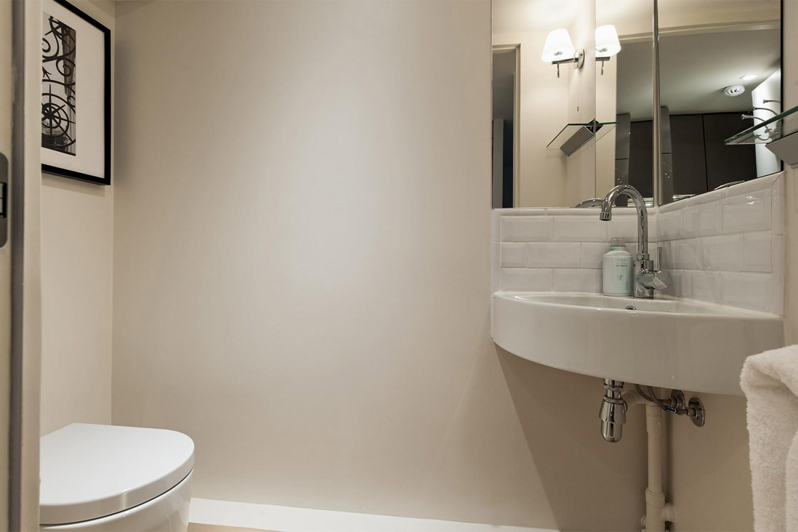 Next to the kitchen, there is an additional half bath.