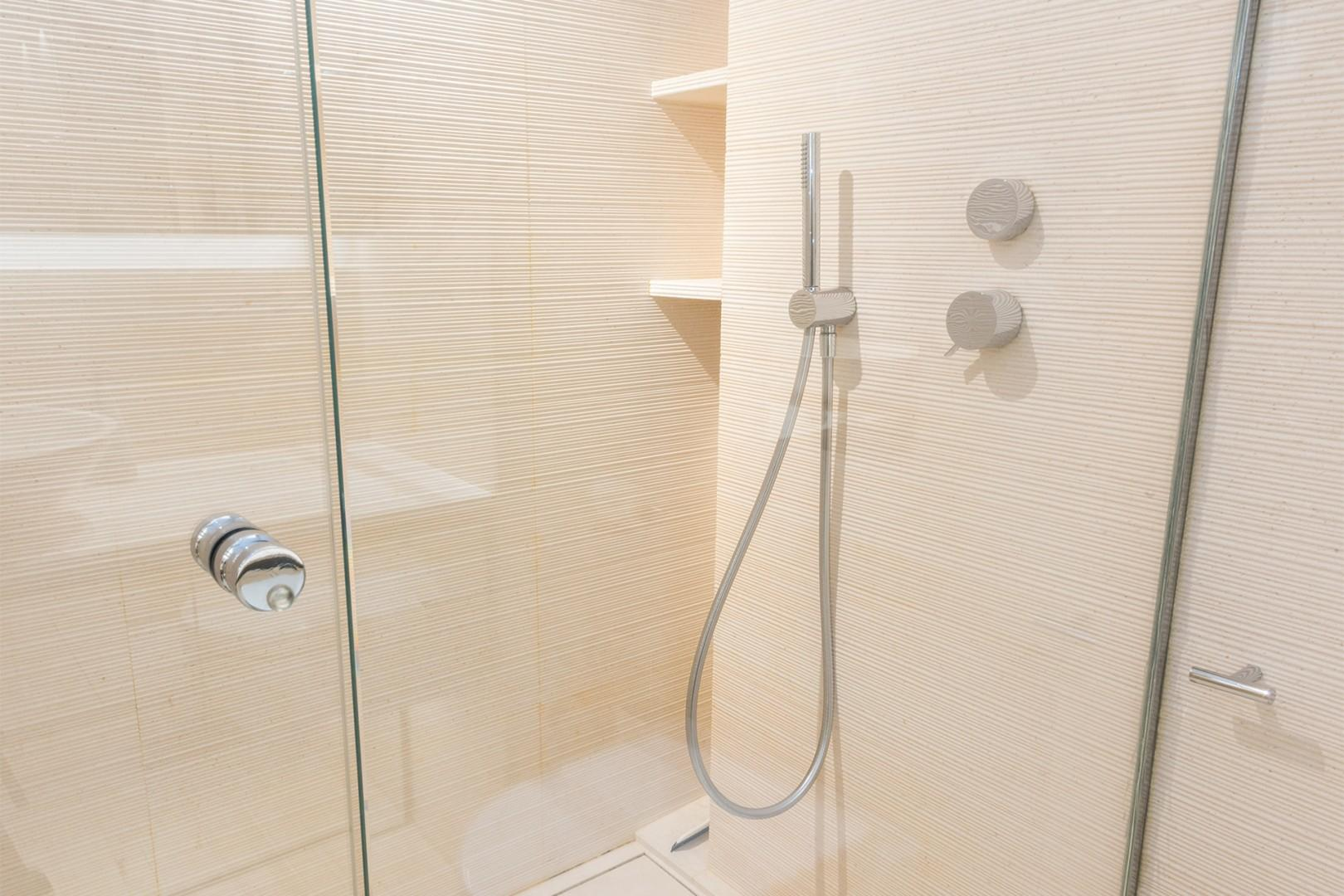 The large shower in bathroom 2 has fixed and flexible shower heads for your convenience.