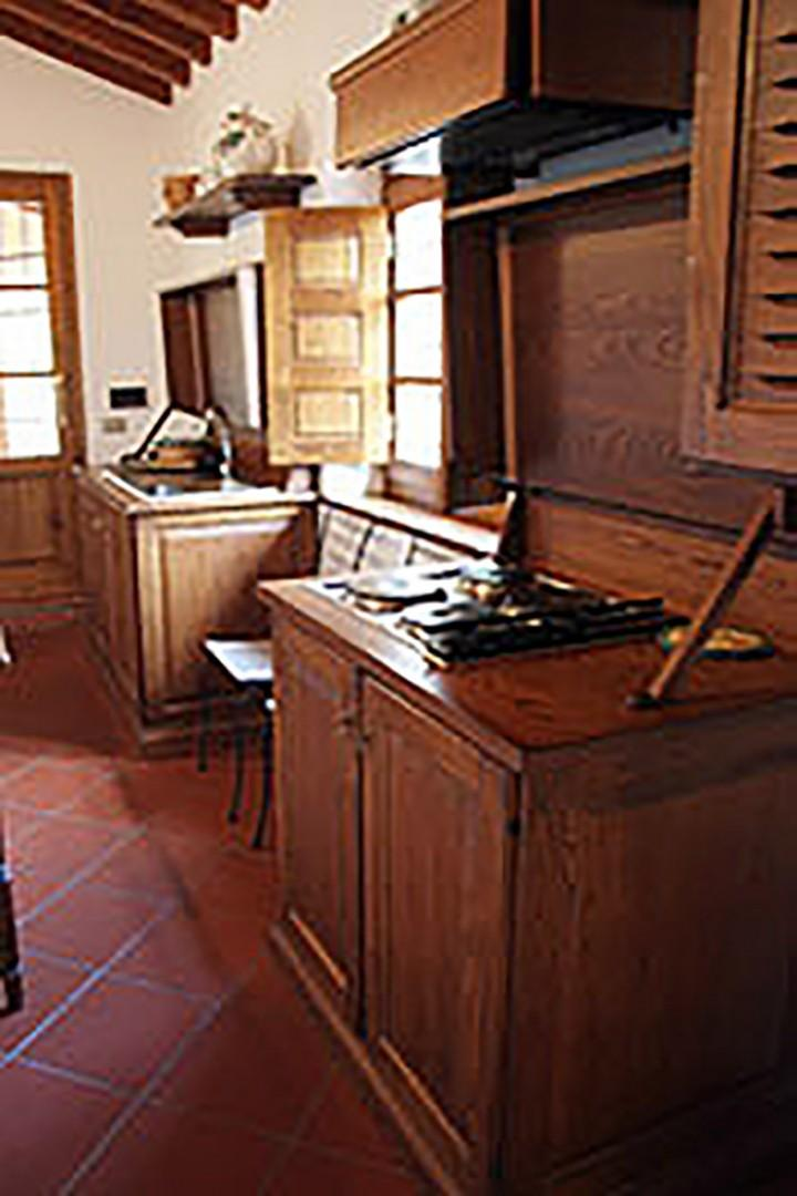 The warm oak of Tuscan style cabinetry in Loggetta's kitchen.