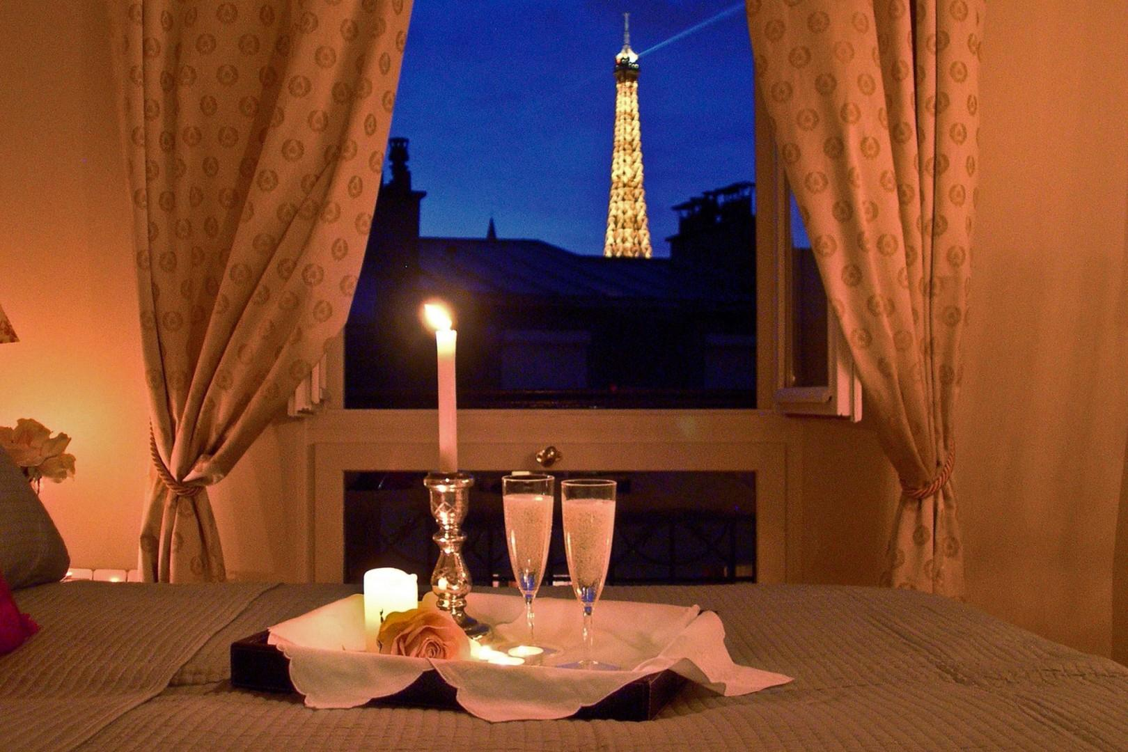 Enjoy stunning evening view of the Eiffel Tower from bedroom 1!