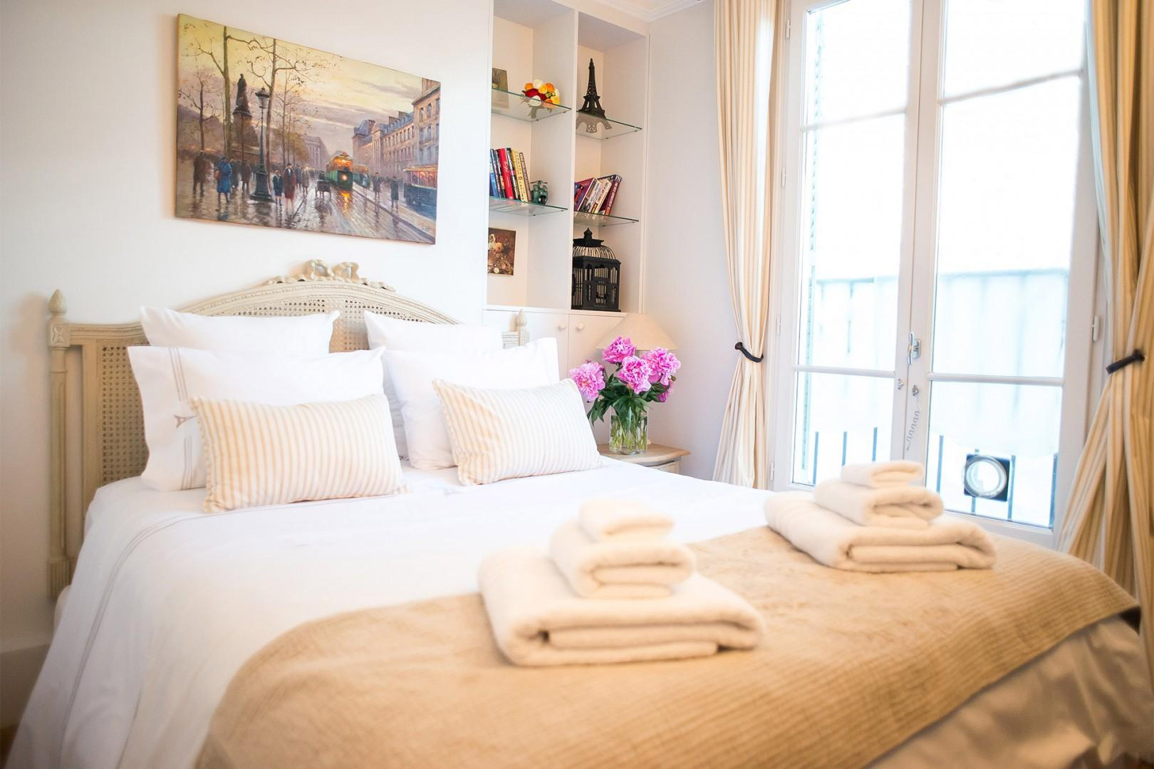 The cozy bedroom 2 is the perfect setting to relax and enjoy Parisian living.