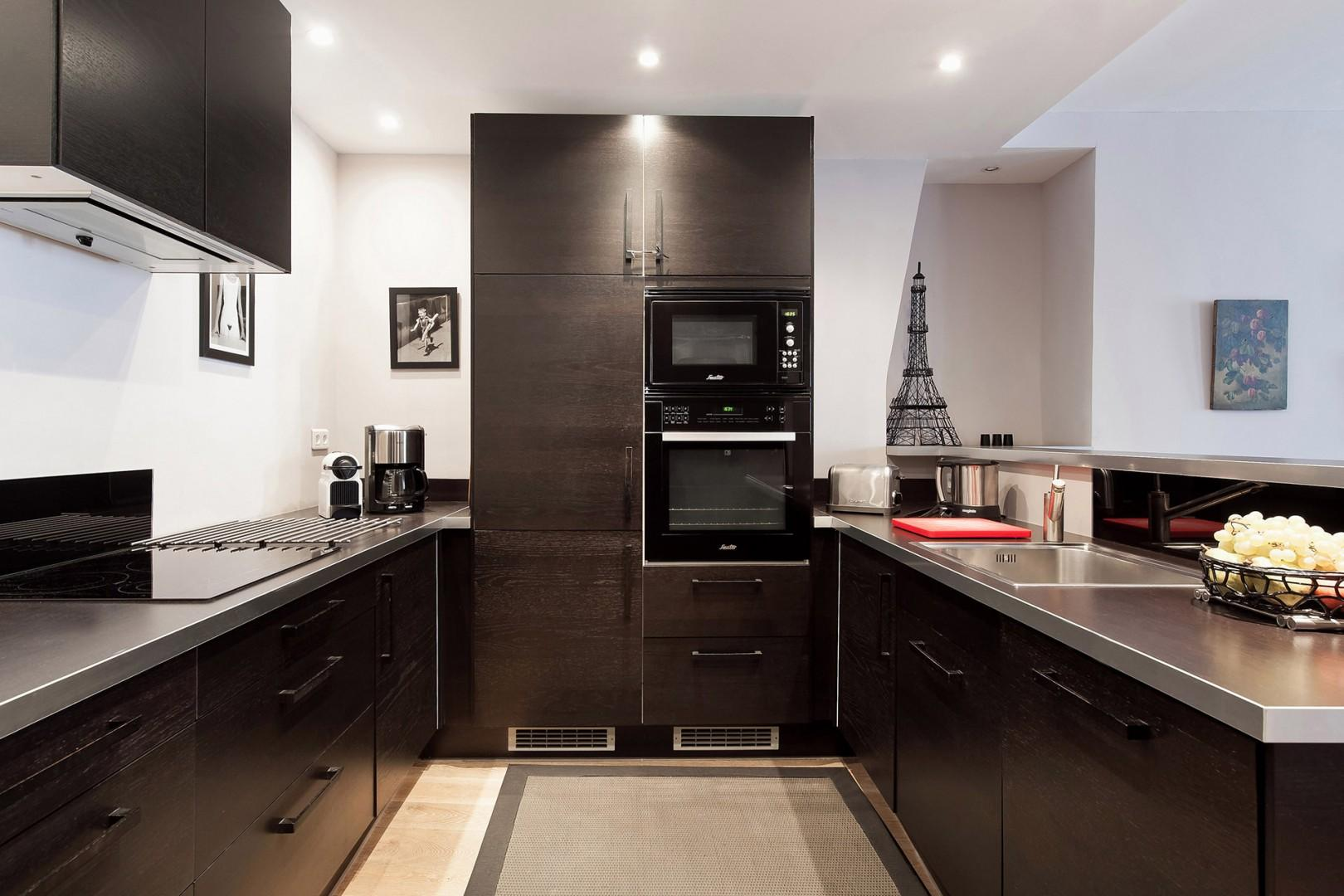 The kitchen will delight chefs with its gorgeous finishes and top-of-the-line appliances.