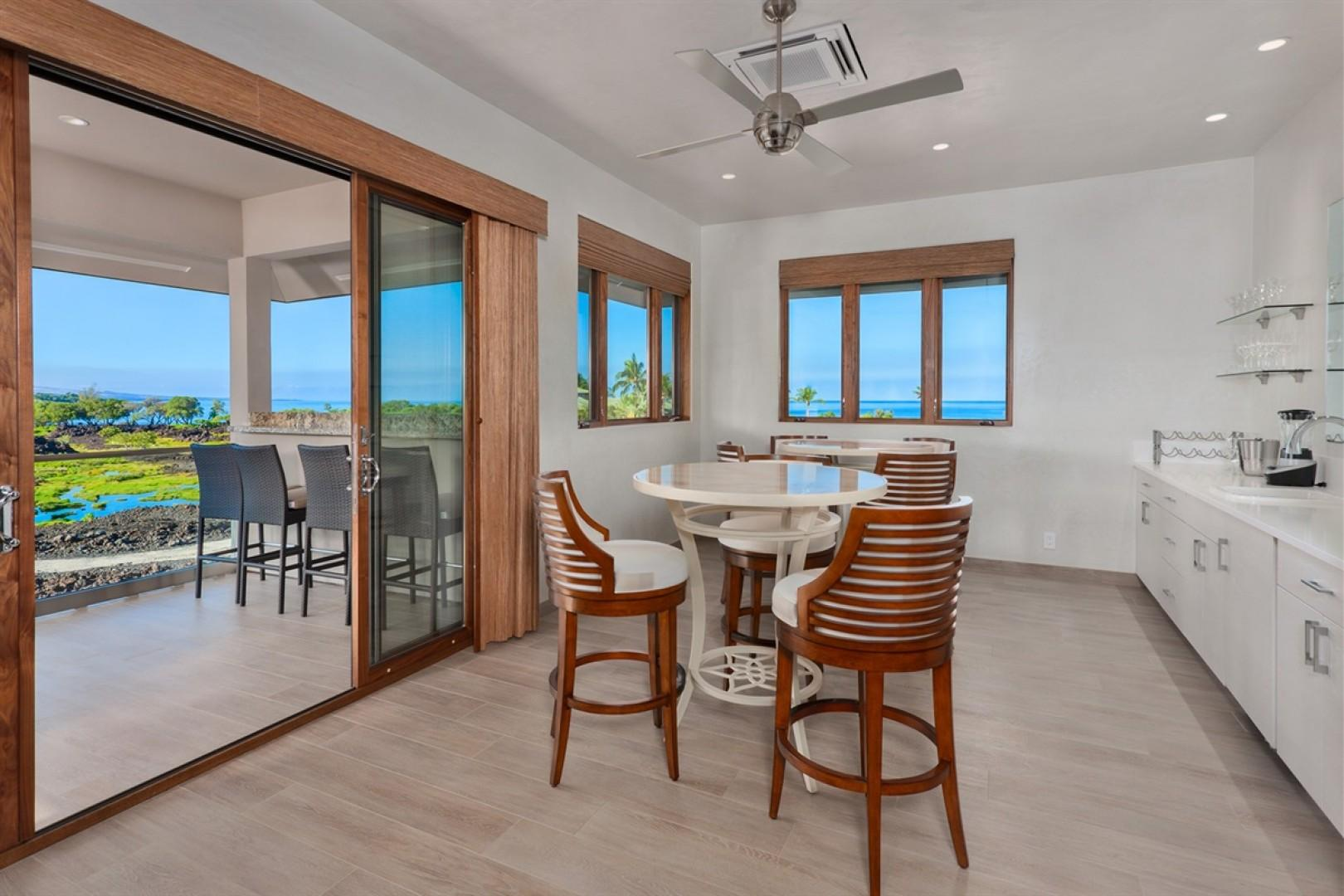 Second floor lounge with wet bar and epic views.