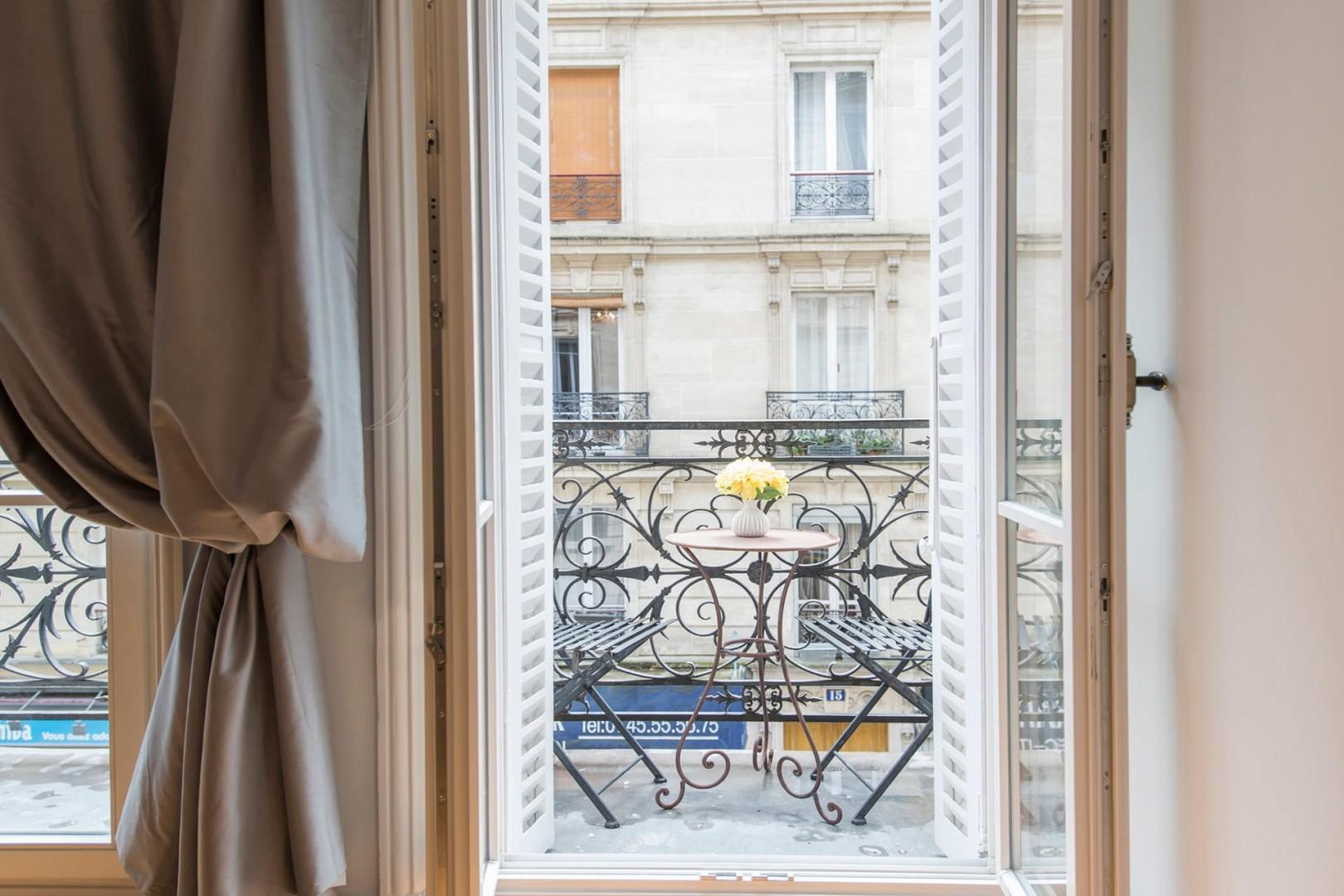 Double French doors lead out to the apartment's balcony.