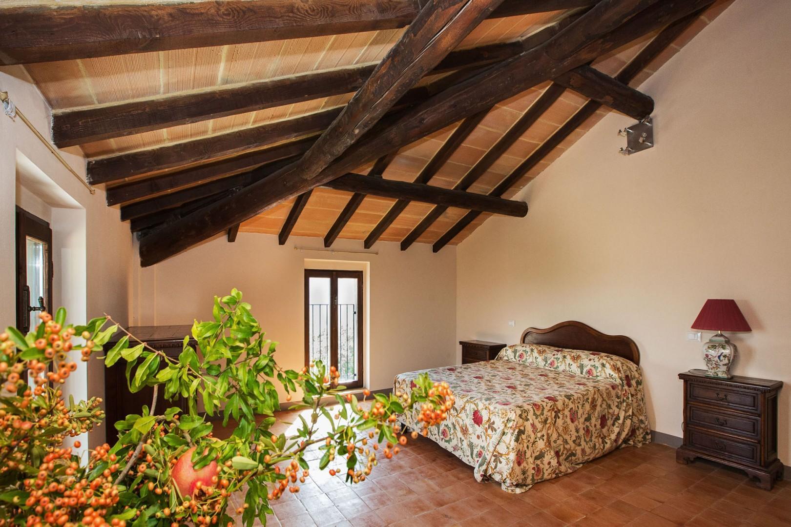 Beamed ceilings in bedroom 6 and 7.