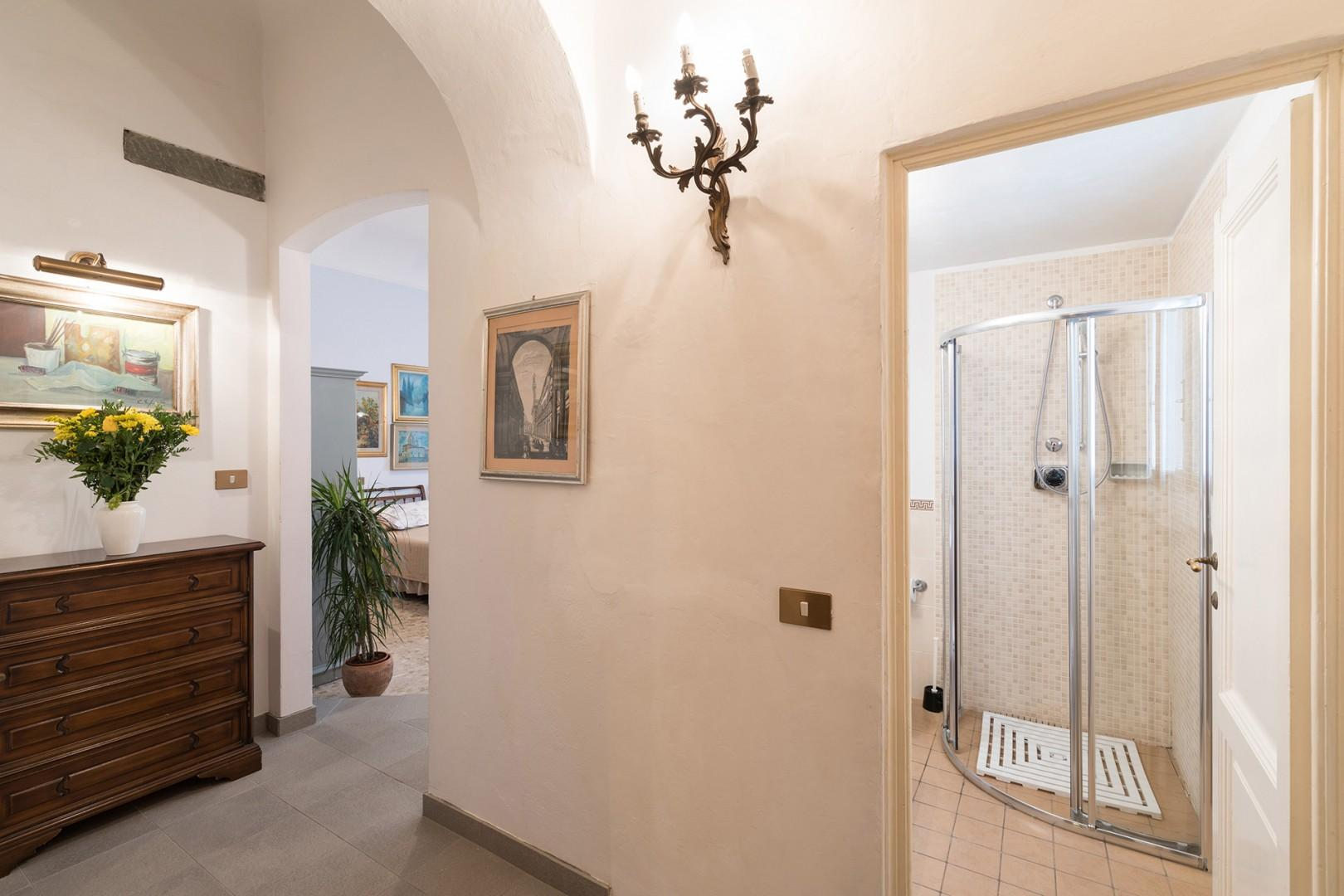 Entrance to full bathroom off the dining area.