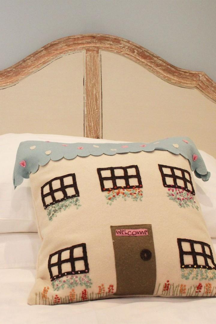 Sweet cushions that look like little English cottages!