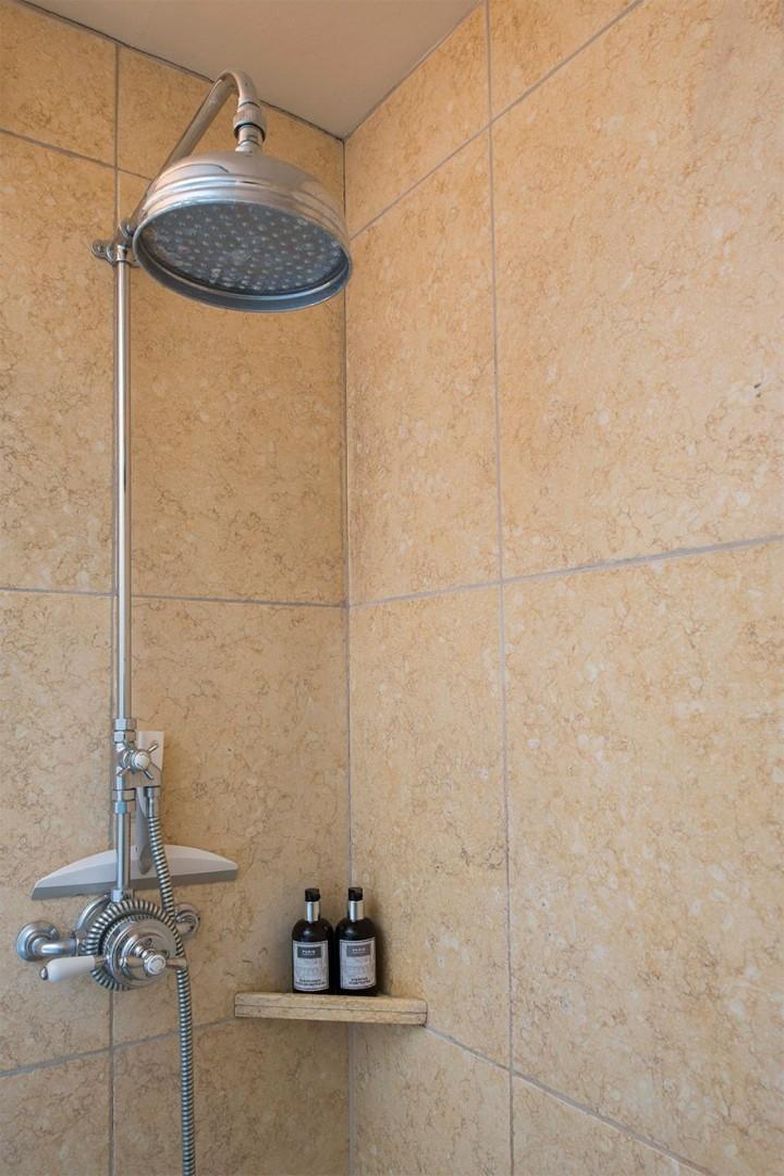 Rainfall showerhead in the first bathroom