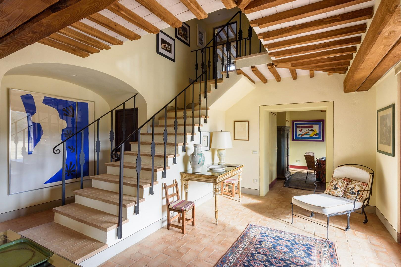 Welcoming entry with stairs leading up to the bedroom level.