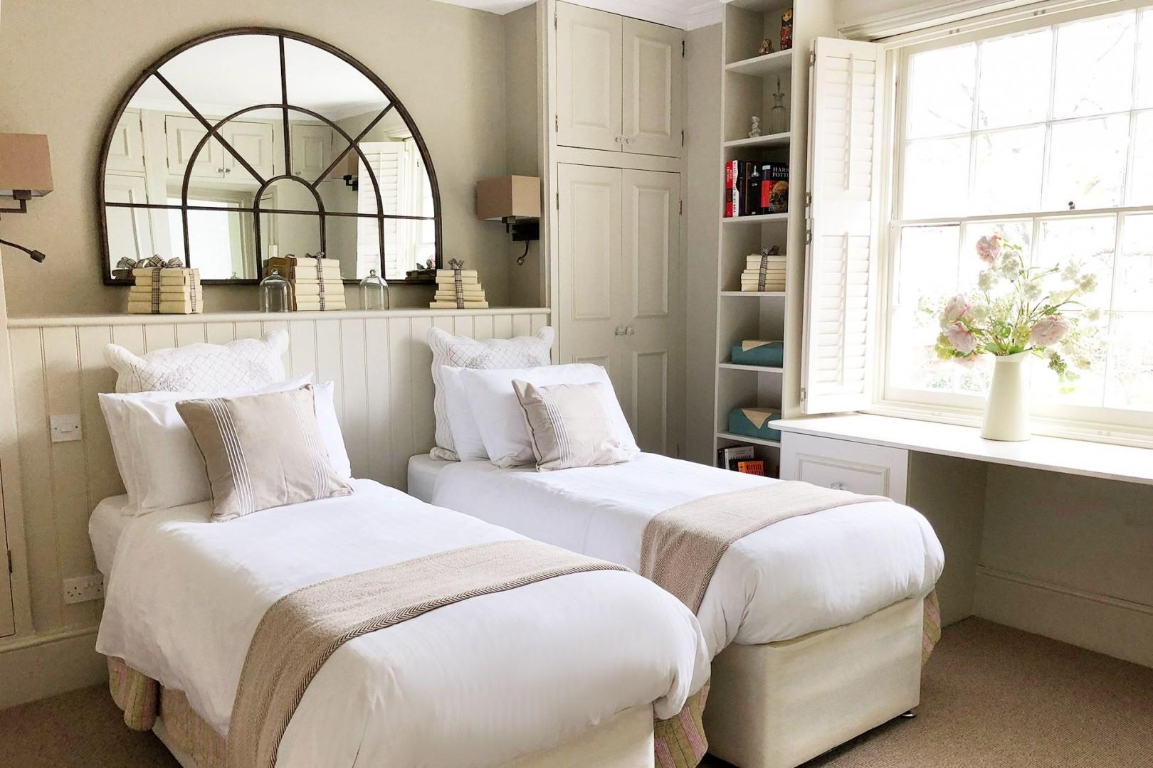Second bedroom with two comfortable beds that can be zipped together to form one bed