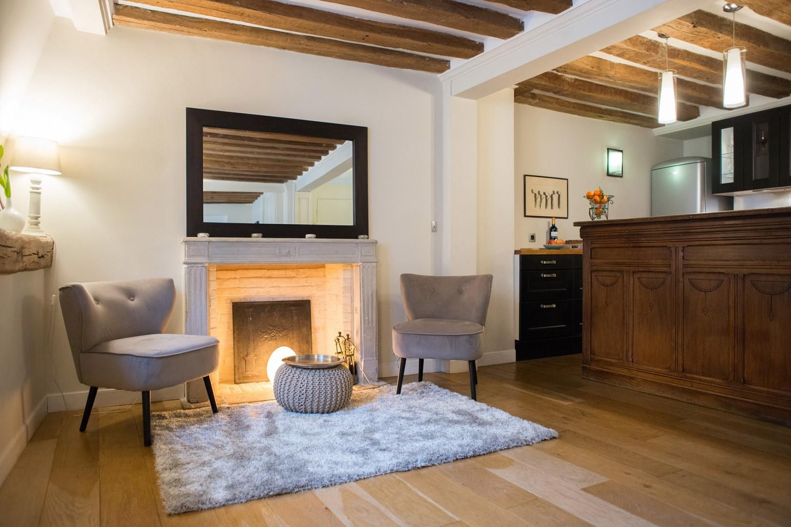 Welcome to the cozy living room with a beautiful exposed beam ceiling!