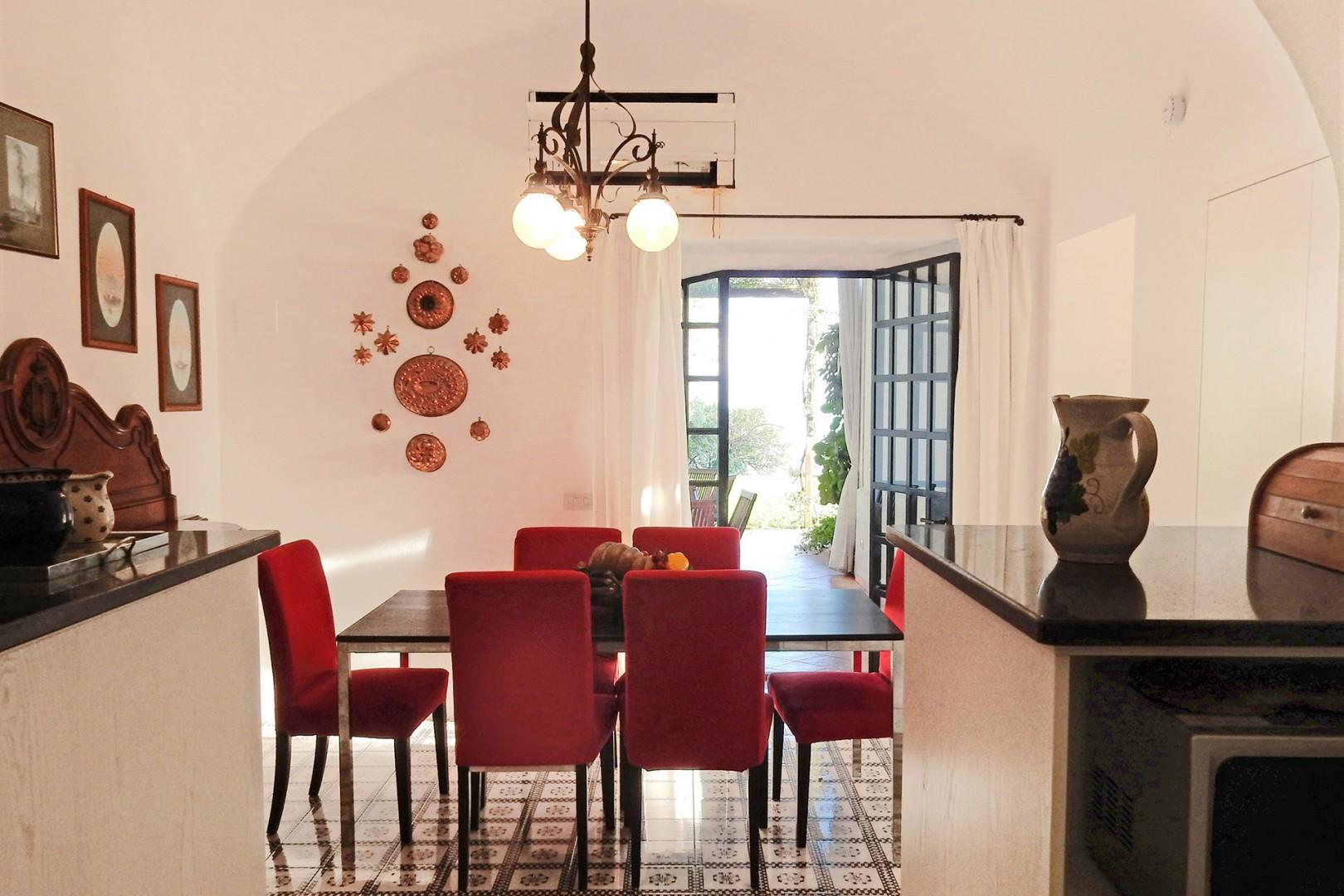 Eat-in kitchen. French doors open out to shaded terrace off kitchen.