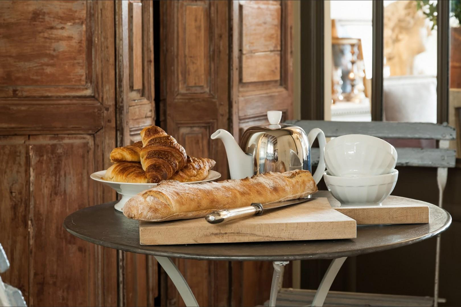 Start your day with a typical Parisian breakfast of croissants, baguettes and coffee!