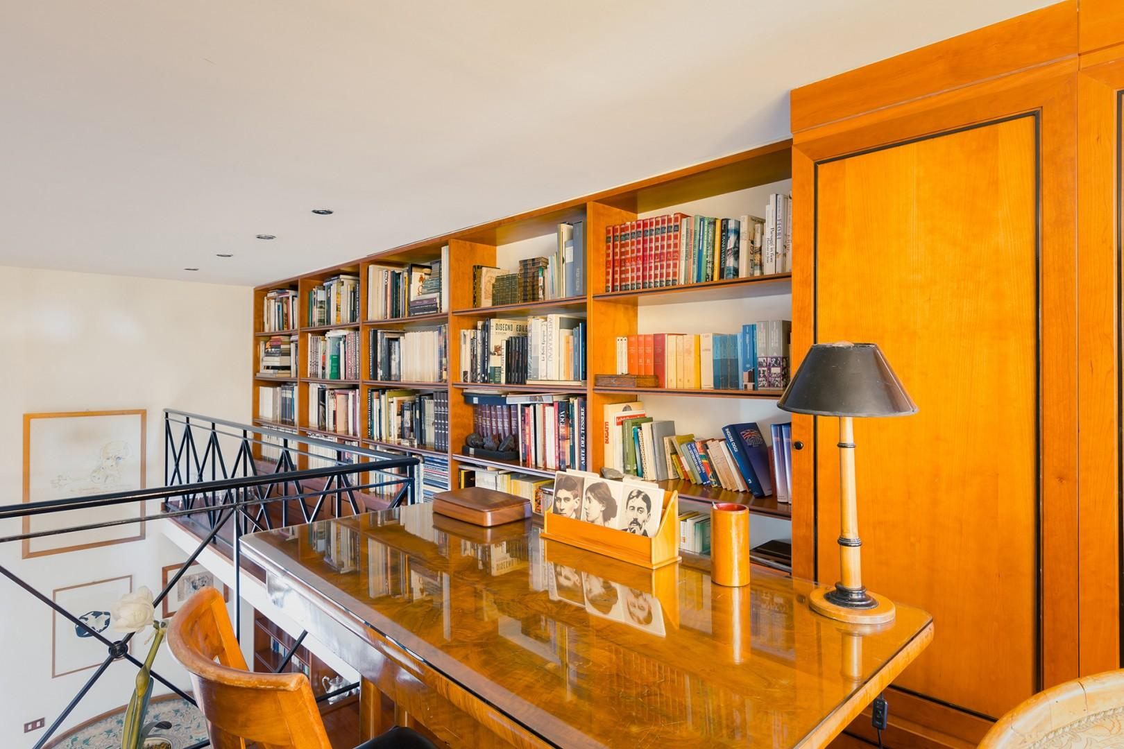 The mezzanine with library and desk above the dining room.