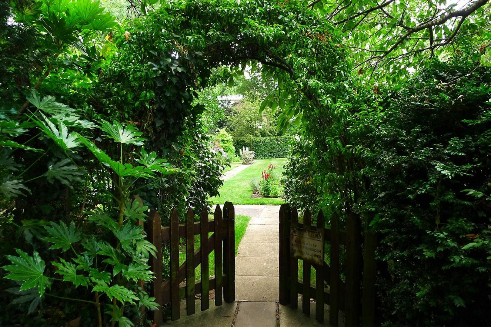 A secluded entrance to the shared garden