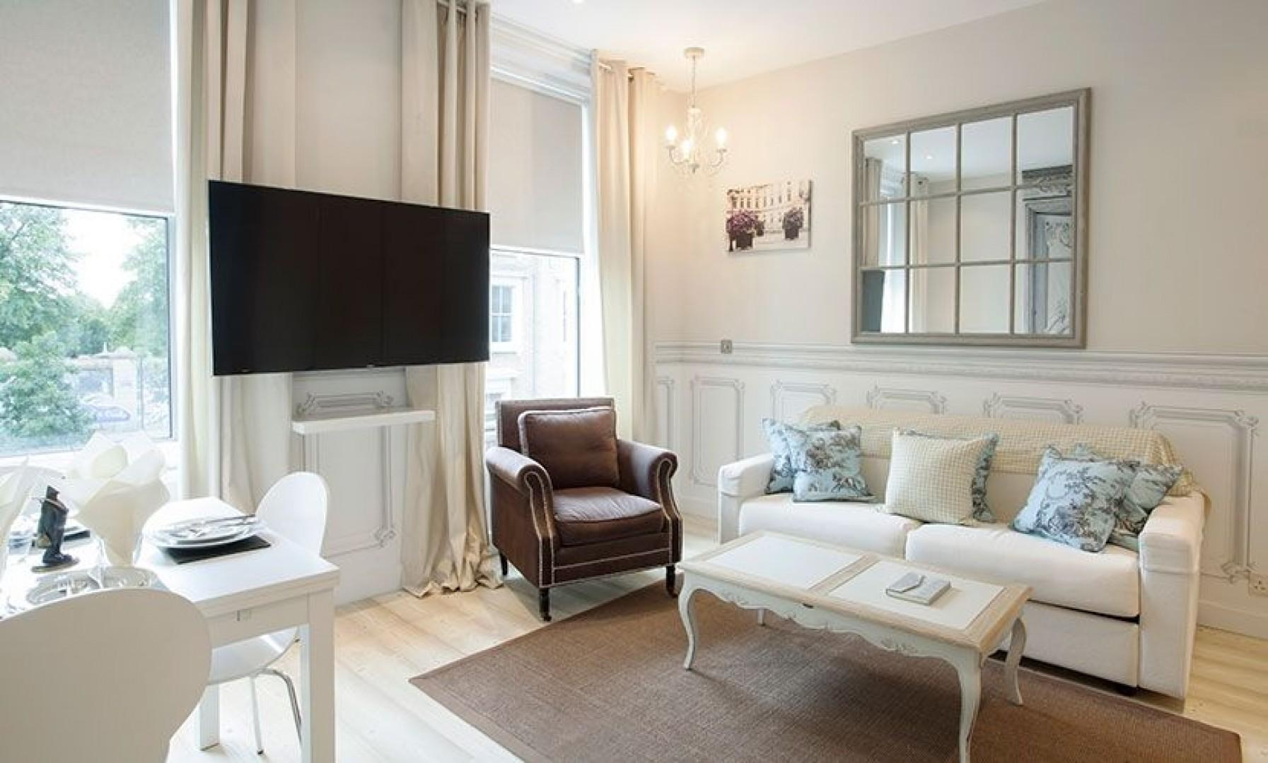 Stylish open plan living with a comfortable sofa that converts into a bed for extra sleeping space