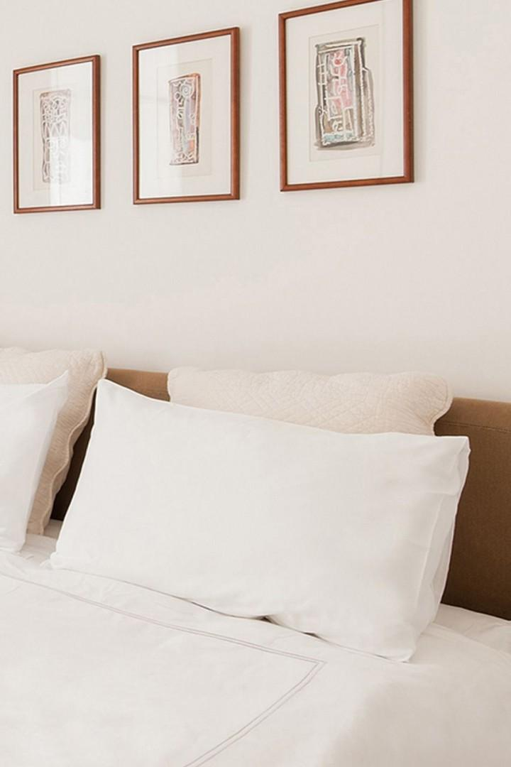 CMS-14-(Only the finest quality pillows and linens are used.)-382112135-26348617-pallette-bed-closeup-1