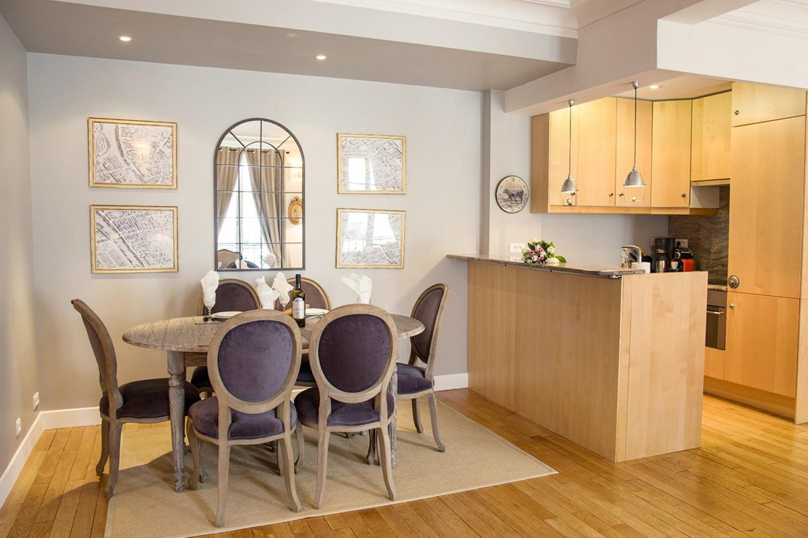 The open-plan dining area and kitchen have an airy feel.