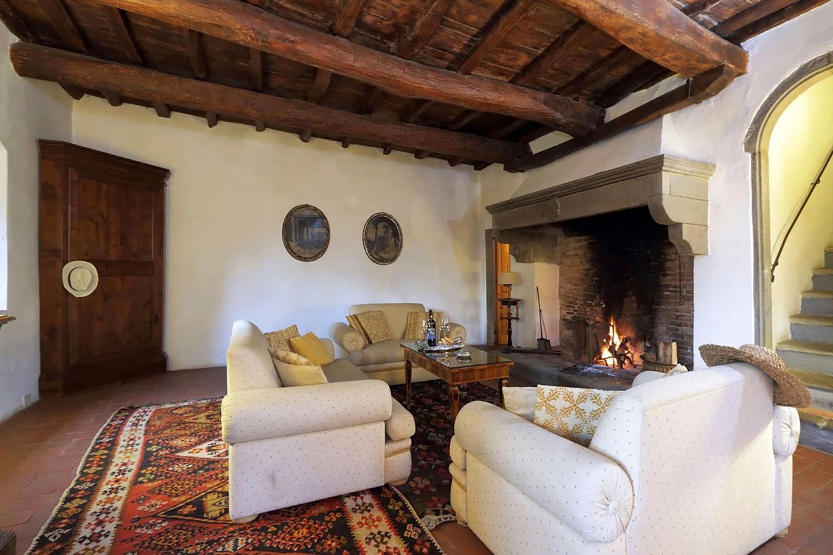 Beautiful antique Kilim carpets grace the floors throughout.