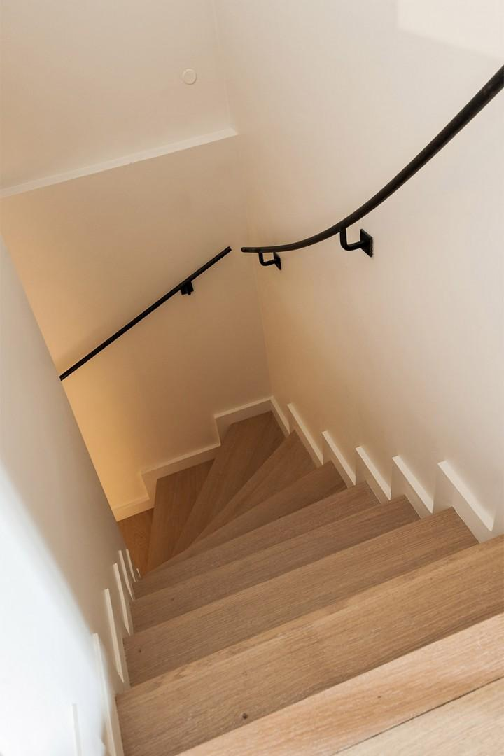 Staircase leading to the apartment's lower level