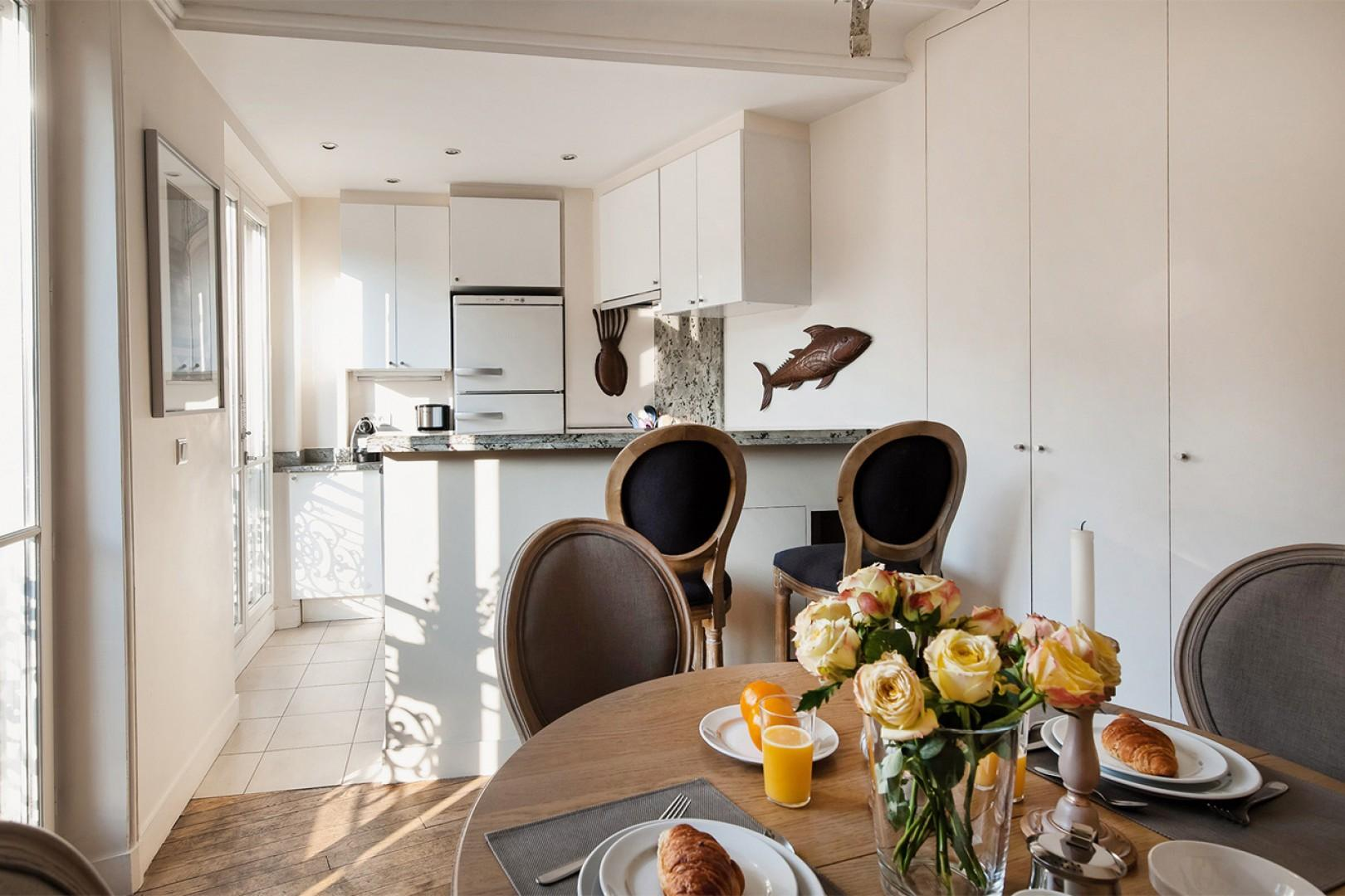 Meals are easy to prepare in the open-plan the kitchen and dining area.